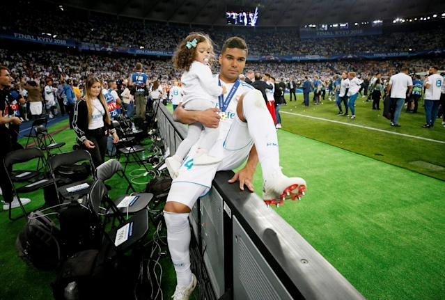 Soccer Football - Champions League Final - Real Madrid v Liverpool - NSC Olympic Stadium, Kiev, Ukraine - May 26, 2018 Real Madrid's Casemiro celebrates with his daughter after winning the Champions League REUTERS/Gleb Garanich