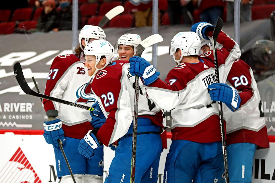 Colorado Avalanche center Nathan MacKinnon (29) celebrates a goal with teammates during a February game against the Arizona Coyotes at Gila River Arena.