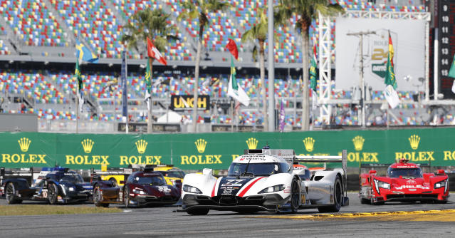 Oliver Jarvis (77) Mazda Dpi leads the field early in the Rolex 24 hour auto race at Daytona International Speedway, Saturday, Jan. 25, 2020, in Daytona Beach, Fla. (AP Photo/Terry Renna)