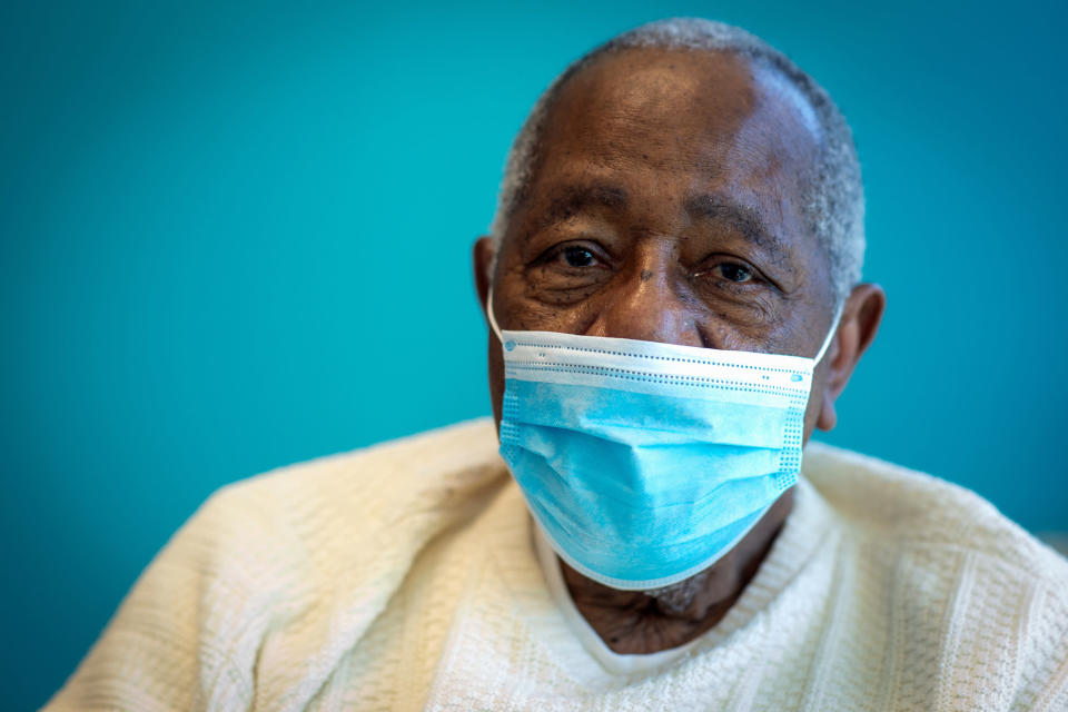 FILE - Baseball Hall of Famer Hank Aaron sits for a portrait after receiving his COVID-19 vaccination at the Morehouse School of Medicine in Atlanta, in this Tuesday, Jan. 5, 2021, file photo. Hank Aaron, who endured racist threats with stoic dignity during his pursuit of Babe Ruth but went on to break the career home run record in the pre-steroids era, died early Friday, Jan. 22, 2021. He was 86. The Atlanta Braves said Aaron died peacefully in his sleep. No cause of death was given. (AP Photo/Ron Harris, File)