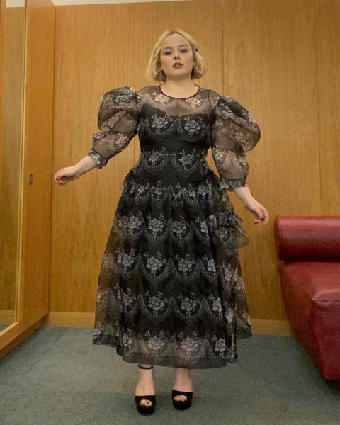 "<p>Coughlan wore a dress by Simone Rocha with heels by Jimmy Choo for her chat show appearance.</p><p><a class=""link rapid-noclick-resp"" href=""https://go.redirectingat.com?id=127X1599956&url=https%3A%2F%2Fwww.net-a-porter.com%2Fen-gb%2Fshop%2Fsearch%2Fsimone%2Brocha&sref=https%3A%2F%2Fwww.elle.com%2Fuk%2Ffashion%2Fcelebrity-style%2Fg35467465%2Fnicola-coughlan-style%2F"" rel=""nofollow noopener"" target=""_blank"" data-ylk=""slk:SHOP SIMONE ROCHA NOW"">SHOP SIMONE ROCHA NOW</a></p><p><a href=""https://www.instagram.com/p/CKFe48dg6t9/"" rel=""nofollow noopener"" target=""_blank"" data-ylk=""slk:See the original post on Instagram"" class=""link rapid-noclick-resp"">See the original post on Instagram</a></p>"