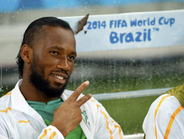 Ivory Coast's Didier Drogba gestures before the 2014 World Cup Group C soccer match between Ivory Coast and Japan at the Pernambuco arena in Recife June 14, 2014. REUTERS/Yves Herman (BRAZIL - Tags: SOCCER SPORT WORLD CUP)