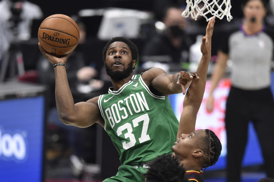 Mar 17, 2021; Cleveland, Ohio, USA; Boston Celtics forward Semi Ojeleye (37) drives to the basket against the Cleveland Cavaliers in the second quarter at Rocket Mortgage FieldHouse.