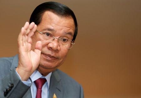 FILE PHOTO - Cambodia's PM Hun Sen gestures as he attends a plenary session at the National Assembly of Cambodia in central Phnom Penh