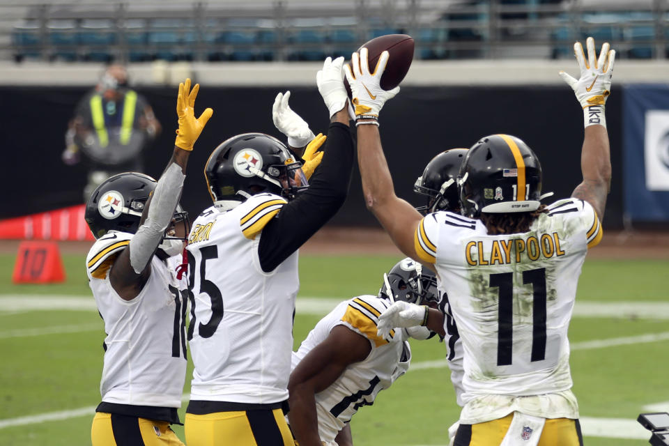 Pittsburgh Steelers players celebrate in the end zone after wide receiver Chase Claypool (11) caught a pass for a touchdown against the Jacksonville Jaguars during the first half of an NFL football game, Sunday, Nov. 22, 2020, in Jacksonville, Fla. (AP Photo/Matt Stamey)
