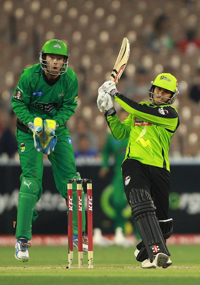 MELBOURNE, AUSTRALIA - JANUARY 08:  Usman Khawaja of the Thunder plays a shot during the Big Bash League match between the Melbourne Stars and the Sydney Thunder at Melbourne Cricket Ground on January 8, 2013 in Melbourne, Australia.  (Photo by Robert Prezioso/Getty Images)