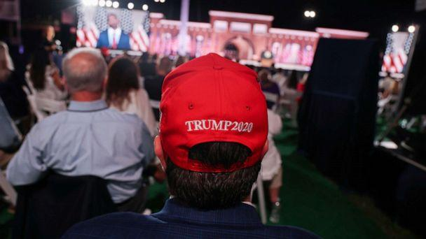 PHOTO: A supporter of President Donald Trump waits for the arrival of Vice President Mike Pence to deliver his acceptance speech during an event of the 2020 Republican National Convention held at Fort McHenry in Baltimore, Aug. 26, 2020. (Jonathan Ernst/Reuters)
