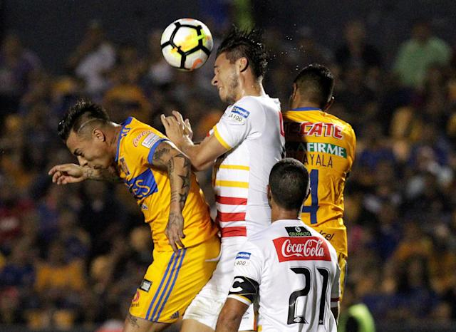 Soccer Football - Tigres v Club Sport Herediano- CONCACAF Champions League - Universitario stadium, Monterrey, Mexico - February 27, 2018 - Juan Pablo Vargas of Club Sport Herediano and Tigres' players Eduardo Vargas and Hugo Ayala in action. REUTERS/Daniel Becerril