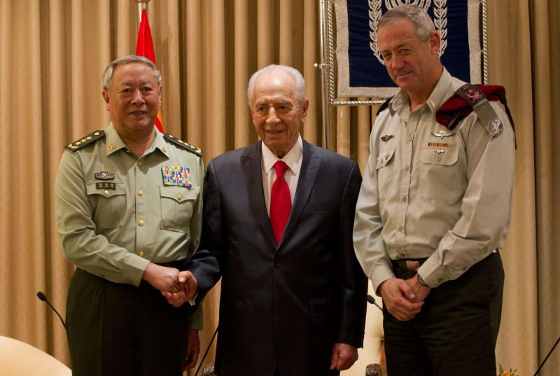 FILE - In this  Aug. 16, 2011 file photo, Gen. Chen Bingde, chief of the General Staff of the Chinese People's Liberation Army, left, Israel's President Shimon Peres, center, and Israel military chief, Lt. Gen. Benny Gantz pose for the media during a meeting at Peres' residence in Jerusalem. After a prolonged chill, security ties between Israel and China are warming up. With Israel offering much-needed technical expertise and China representing a huge new market and influential voice in the international debate over Iran's nuclear program, the two nations have stepped up military cooperation as they patch up a rift caused by a pair of failed arms deals scuttled by the U.S. (AP Photo/Bernat Armangue, File)