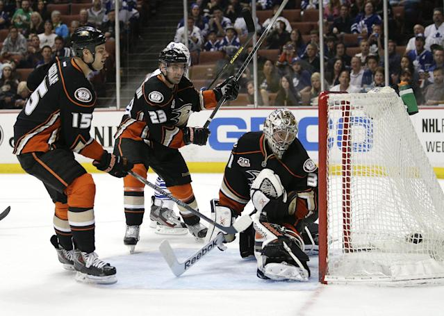 Anaheim Ducks' Ryan Getzlaf, from left, Francois Beauchemin and goalie Frederik Andersen, of Denmark, watch a goal by Toronto Maple Leafs' Tyler Bozak during the first period of an NHL hockey game on Monday, March 10, 2014, in Anaheim, Calif. (AP Photo/Jae C. Hong)