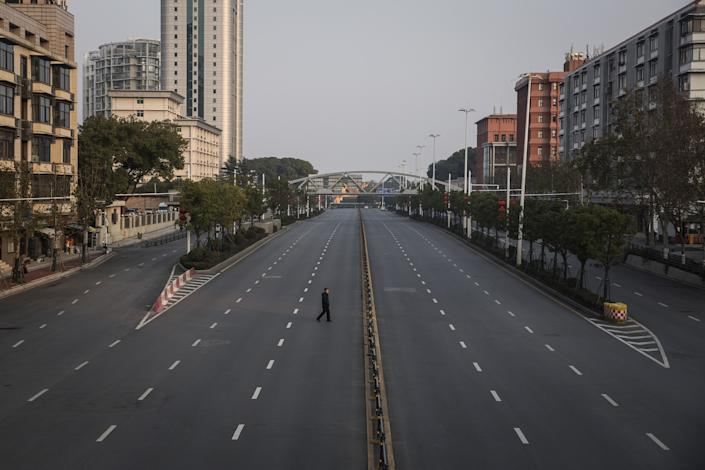 "A man crosses an empty highway on Feb. 3, 2020, in Wuhan, China, the epicenter of the global coronavirus outbreak. <span class=""copyright"">(Getty Images)</span>"