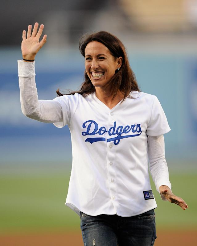LOS ANGELES, CA - AUGUST 08: US Olympic swimmer Janet Evans waves after throwing the ceremonial first pitch prior to start of the basbeall game between the Philadelphia Phillies and Los Angeles Dodgers at Dodger Stadium on August 8, 2011 in Los Angeles, California. (Photo by Kevork Djansezian/Getty Images)