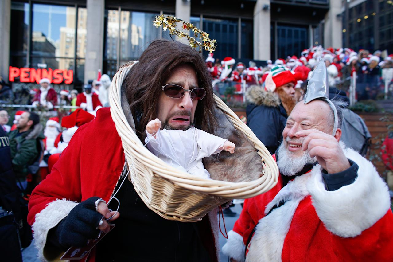<p>NEW YORK, NY – DECEMBER 08: A man dressed up as Baby Jesus takes part during the annual New York SantaCon on December 8, 2018 in New York City. SantaCon is in it's 20th year in New York City. (Photo by Kena Betancur/Getty Images) </p>