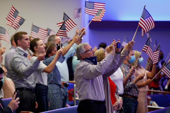 Attendees wave flags at First Baptist Church Dallas on June 28, 2020. (Photo: (AP Photo/Tony Gutierrez))