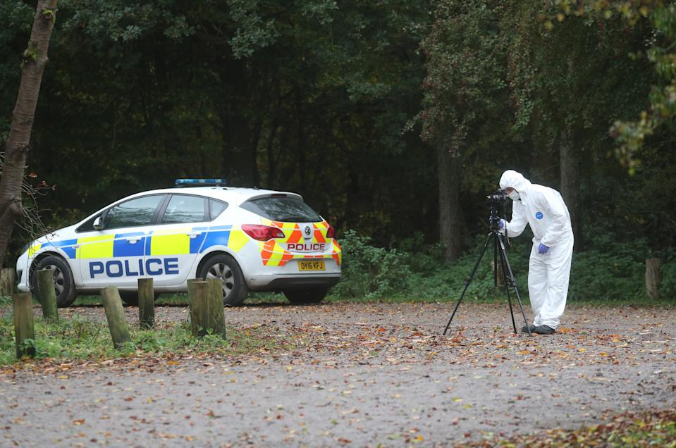 Forensic investigators at Watlington Hill in Oxfordshire after the body of a woman was discovered at the National Trust estate, a man has been arrested on suspicion of murder and is being treated for serious injuries, police said.