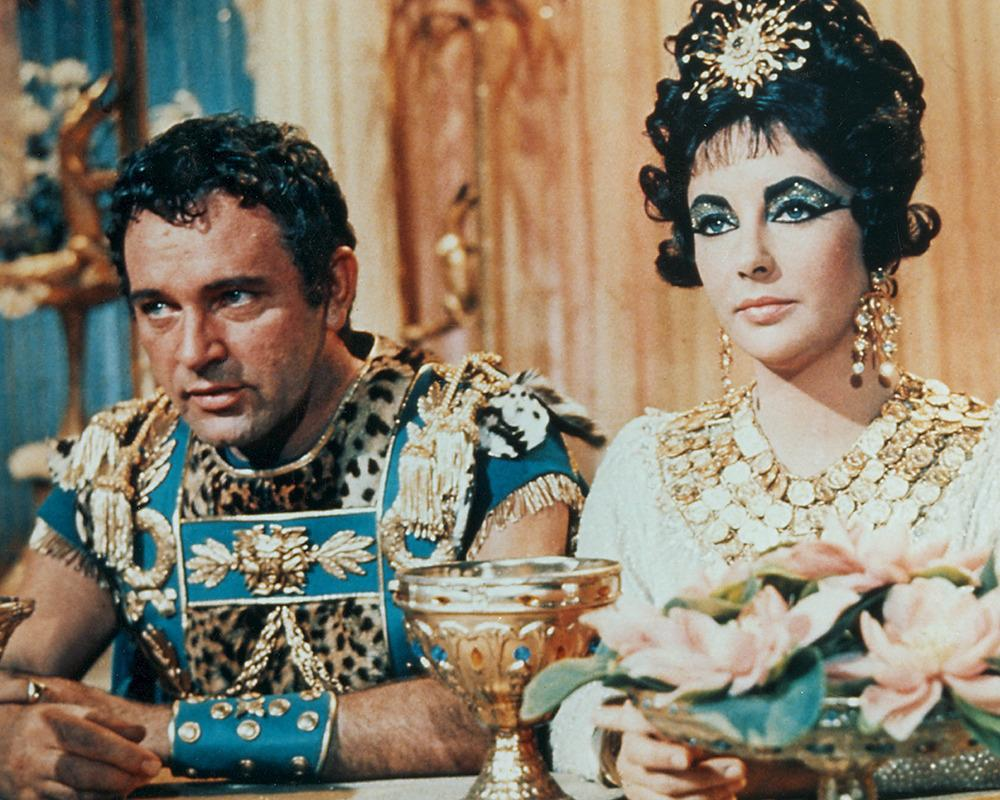 'Cleopatra' (1963) - Elizabeth Taylor & Richard Burton Liz Taylor and Richard Burton's fiery relationship is one of the most famous in celebrity history. The pair were married and divorced a couple of times and kept gossipers the world over chattering with their wild behaviour.Their beginnings were not without controversy either – Liz left her singer hubby Eddie Fisher for the Welsh acting legend thanks to a public affair during the shooting of the Egyptian epic. Taylor and Fisher's pairing had always been slightly frowned upon anyway since Liz's ex before Eddie was Eddie's best friend who had died. And Eddie left America's darling Debbie Reynolds for Taylor. Confusing, eh?!