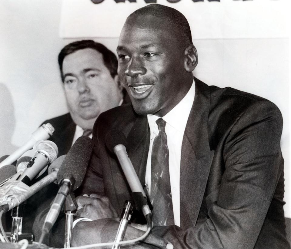 Jerry Krause, left, general manager of the Chicago Bulls, is shown with Bulls legend Michael Jordan in this Sept. 20, 1988 photo after Jordan agreed to an eight-year contract extension. Krause, who built a team around Jordan that won six national titles, resigned Monday, April 7, 2003, citing health problems. (AP Photo/Mark Elias)