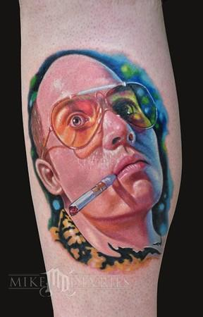 """<div class=""""caption-credit""""> Photo by: Mike Devries/mdtattoos.com</div>Johnny Depp's desire to be Hunter Thompson is actualized on a mysterious body part. (Arm? Calf? Human engineered limb-like substance commissioned by Johnny Depp for personal collection?)"""