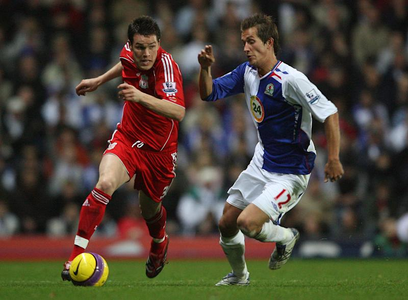 Blackburn Rovers Morten Gamst Pedersen and Liverpool's Steve Finnan (Photo by Dave Howarth - PA Images via Getty Images)
