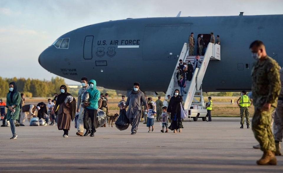 Refugees disembark from a US air force aircraft after an evacuation flight from Kabul at the Rota naval base in Rota, southern Spain, on 31 August 2021. - Japan was heavily criticised for evacuating just one passenger on its C-130 aircraft. (AFP via Getty Images)