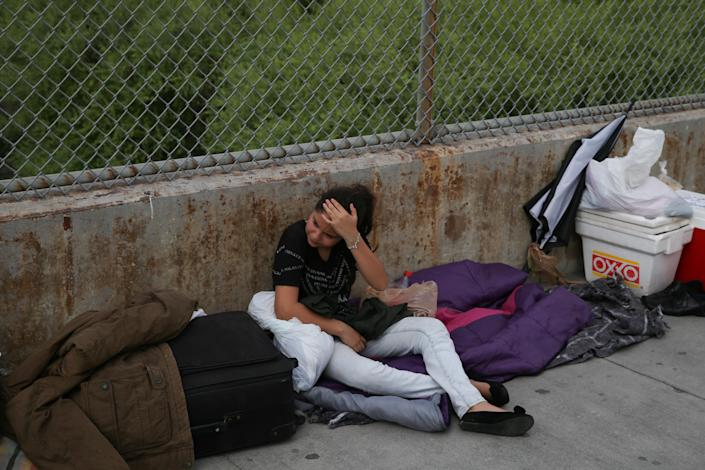 """<span class=""""s1"""">Aura, 13, an asylum seeker from Guatemala traveling with her father, waits on the Mexican side of the Brownsville-Matamoros International Bridge after being denied entry by ICE on July 25. (Photo: Loren Elliott/Reuters)</span>"""
