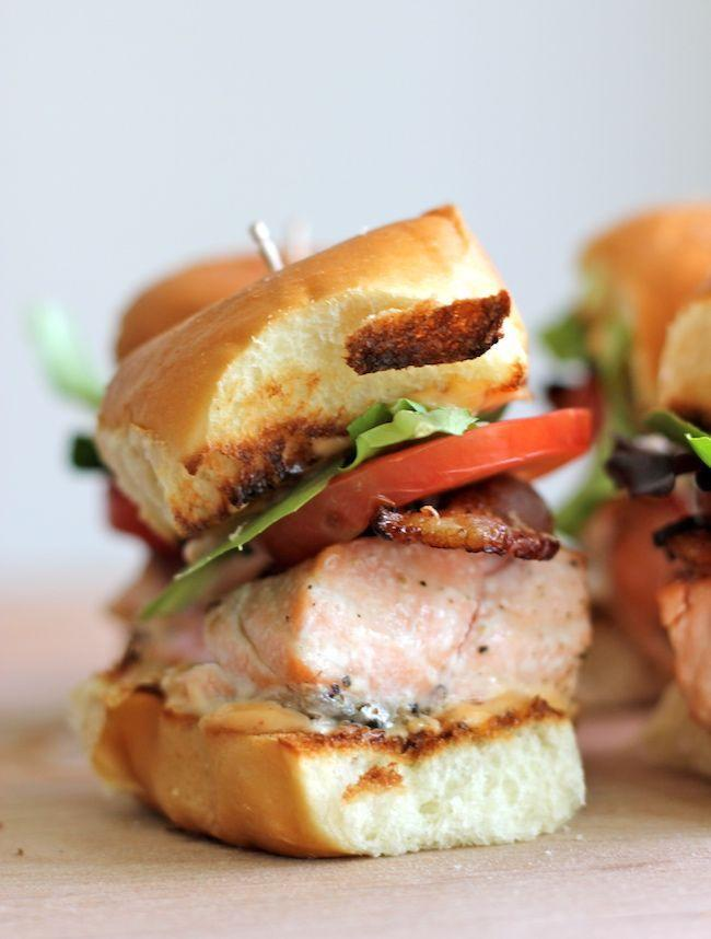 """<p>Whip up some next-level mini BLTs by layering broiled salmon with bacon, lettuce, and tomato on slider buns. Slather with an easy two-ingredient chipotle mayo for some added heat.</p><p><strong>Get the recipe at <a href=""""https://damndelicious.net/2012/06/06/salmon-blt-sliders-with-chipotle-mayo/"""" rel=""""nofollow noopener"""" target=""""_blank"""" data-ylk=""""slk:Damn Delicious"""" class=""""link rapid-noclick-resp"""">Damn Delicious</a>.</strong> </p>"""
