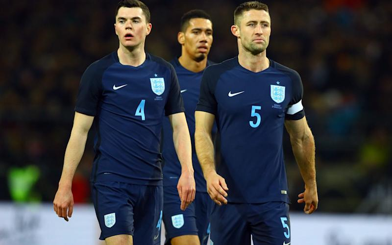 Chris Smalling (centre) is unavailable - Rex Features