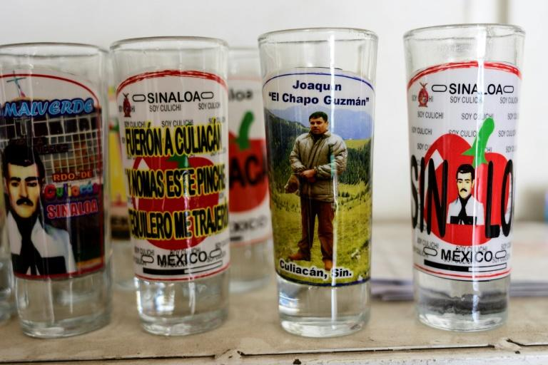 "A shot glass bearing a picture of drug lord Joaquin ""El Chapo"" Guzman, who ultimately lived a lifestyle far removed from the poverty in Mexico's Sinaloa region (AFP Photo/Pedro PARDO)"