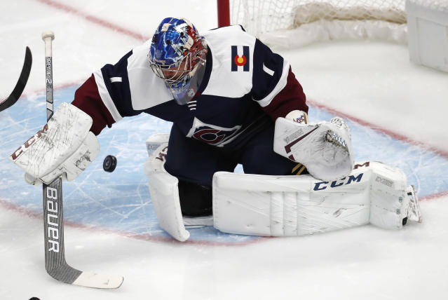 Colorado Avalanche goaltender Semyon Varlamov stops a shot by the Nashville Predators in the first period of an NHL hockey game Wednesday, Nov. 7, 2018, in Denver. (AP Photo/David Zalubowski)