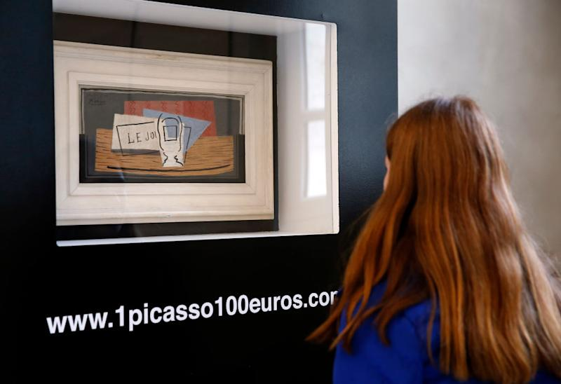 """PARIS, FRANCE - FEBRUARY 14: A visitor looks at a painting entitled """"Still life"""" by Spanish artist Pablo Picasso at Picasso museum on February 14, 2020, in Paris, France. A lottery will allow the winner to win an artwork by the artist for 100 euros. To participate, you have to buy a ticket worth 100 euros on the website 1picasso100euros.com, the draw will take place on March 30, 2020. Collector David Nahmad was kind enough to part with his canvas which is on display at the entrance to the Parisian museum dedicated to the Spanish painter. With the lottery, the organizers hope to raise 20 million euros which will go to the NGO Care for access to water in Africa. (Photo by Chesnot/Getty Images)"""
