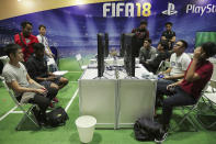 <p>A gamer reacts after losing a point while playing a round of FIFA18 at Asia Game Festival 2018. (PHOTO: Don Wong) </p>