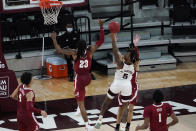 Mississippi State guard Deivon Smith (5) shoots past a block attempt by Alabama guard John Petty Jr. (23) during the second half of an NCAA college basketball game in Starkville, Miss., Saturday, Feb. 27, 2021. (AP Photo/Rogelio V. Solis)