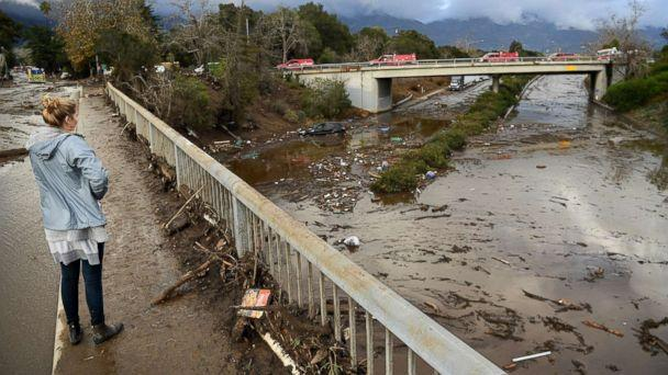 PHOTO: A woman looks at the 101 freeway from Olive Mill Road in Montecito, Calif., Jan. 9. 2018, after heavy rainfall brought mudslides and debris cascading down from hillsides denuded by recent wildfires. (Wally Skalij/Los Angeles Times via Polaris)