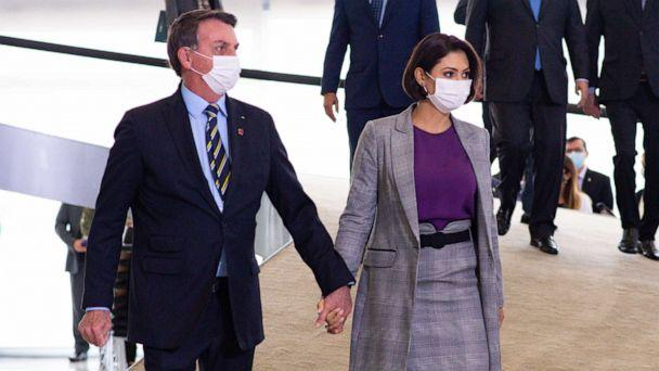 PHOTO: In this June 17, 2020, file photo, President of Brazil, Jair Bolsonaro and First Lady Michelle Bolsonaro arrive for a ceremony at the Planalto Palace in Brasilia. (Andressa Anholete/Getty Images, FILE)