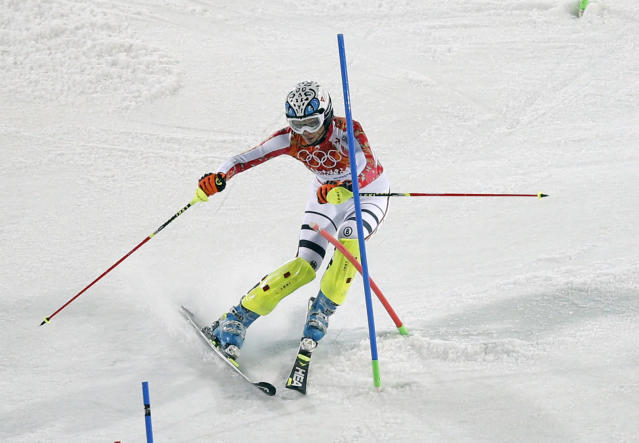 Germany's Maria Hoefl-Riesch passes a gate during the second run of the women's slalom at the Sochi 2014 Winter Olympics, Friday, Feb. 21, 2014, in Krasnaya Polyana, Russia. (AP Photo/Christophe Ena)