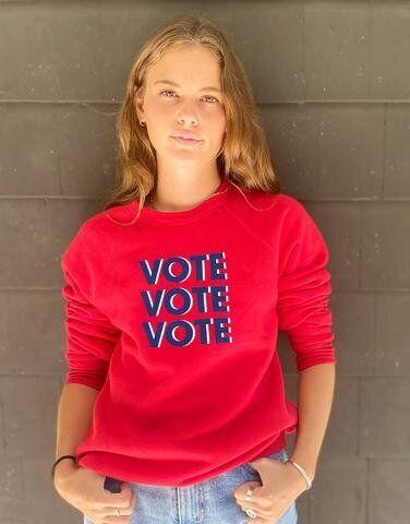 "<strong>Get the <a href=""https://www.social-goods.com/collections/the-vote-collection/products/the-vote-sweatshirt"" target=""_blank"" rel=""noopener noreferrer"">Social Goods ""Vote Vote Vote"" sweatshirt</a>, as seen on <a href=""https://www.dailymail.co.uk/tvshowbiz/article-8765605/Jennifer-Garner-encourages-vote-bright-red-sweater-running-errands-LA.html"" target=""_blank"" rel=""noopener noreferrer"">Jennifer Garner</a>, for $85.</strong>"