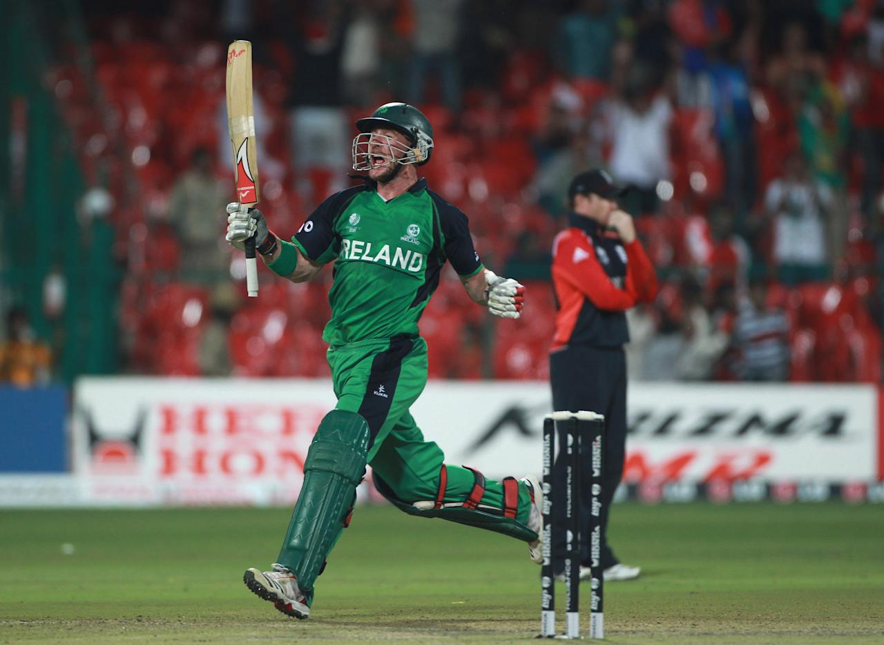 BANGALORE, INDIA - MARCH 02:  John Mooney of Ireland celebrates after scoring the winning runs during the 2011 ICC World Cup Group B match between England and Ireland at the M. Chinnaswamy Stadium on March 2, 2011 in Bangalore, India.  (Photo by Tom Shaw/Getty Images)