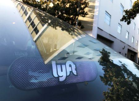 FILE PHOTO - An illuminated sign appears in a Lyft ride-hailing car in Los Angeles