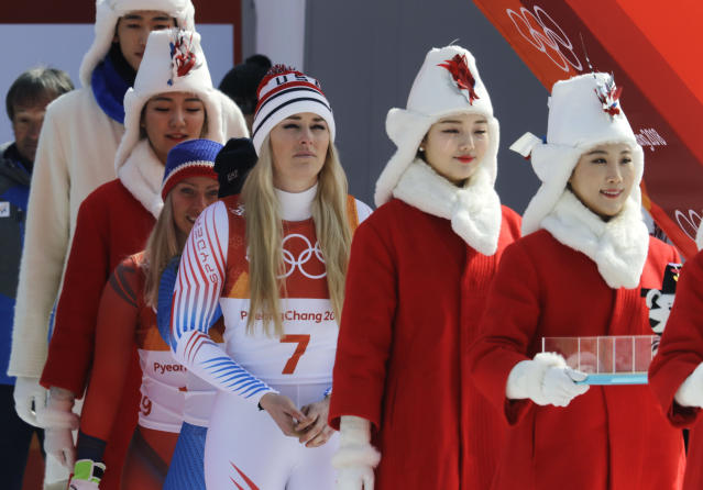 <p>Bronze medal winner United States' Lindsey Vonn, center, walks to the flower ceremony for the women's downhill at the 2018 Winter Olympics in Jeongseon, South Korea, Wednesday, Feb. 21, 2018. (AP Photo/Michael Probst) </p>