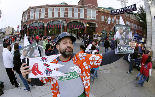 As MLB plays on, the businesses it feeds fight for survival