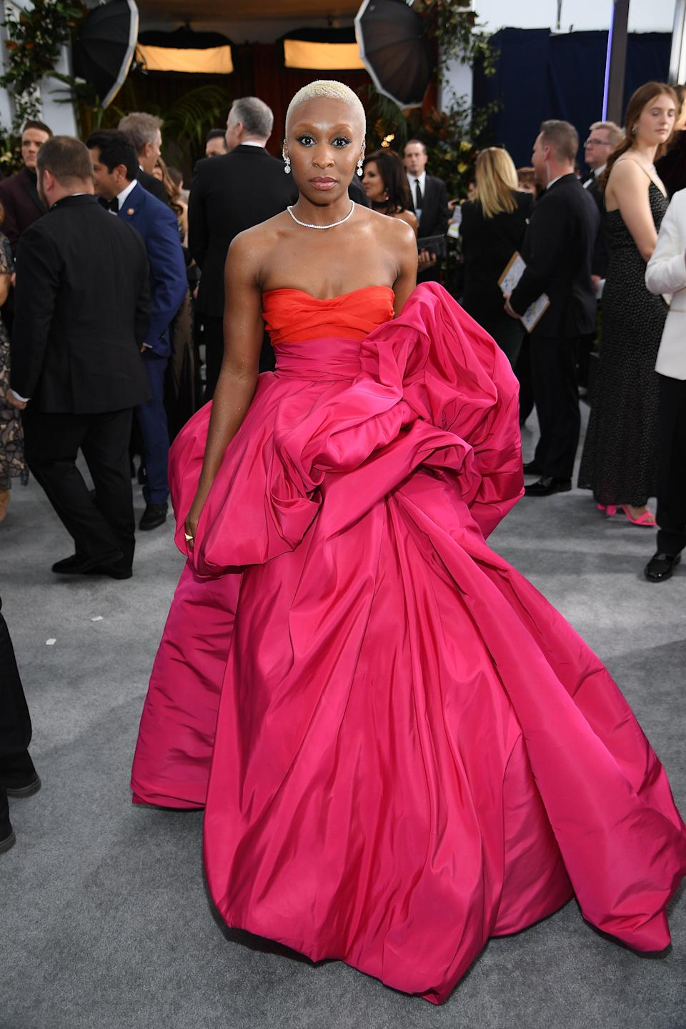 """<h2>Cynthia Erivo in Schiaparelli</h2><br><em>Harriet</em>'s Cynthia Erivo just made Valentine's Day come early with this strapless, red-on-magenta gown.<span class=""""copyright"""">Photo: Dimitrios Kambouris/Getty Images.</span>"""