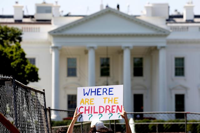 <p>An immigration activists hold signs against family separation during a rally to protest against the Trump Administration's immigration policy outside the White House in Washington, June 30, 2018. (Photo: Joshua Roberts/Reuters) </p>