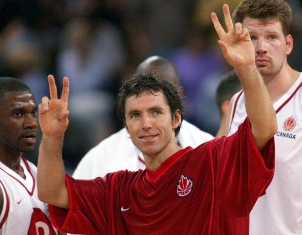 Canada's Steve Nash celebrates his team's 91-77 victory over Spain in the 2000 Sydney Olympics. The basketball star became the first Canadian elected to the FIBA Hall of Fame on Tuesday. (Kevin Frayer/The Canadian Press - image credit)
