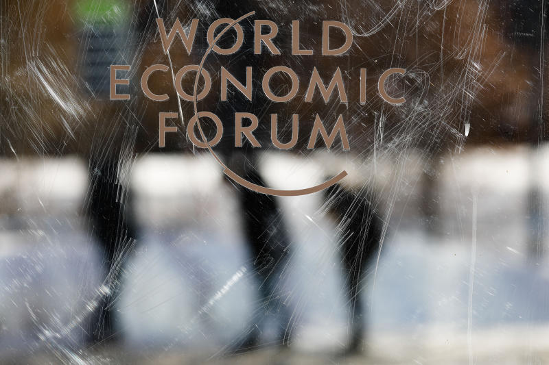 The logo of the World Economy Forum is displayed on a door at the Congress Centre in Davos, Switzerland, Sunday, Jan. 19, 2020. The 50th annual meeting of the World Economic Forum will take place in Davos from Jan. 20 until Jan. 24, 2020. (AP Photo/Markus Schreiber)