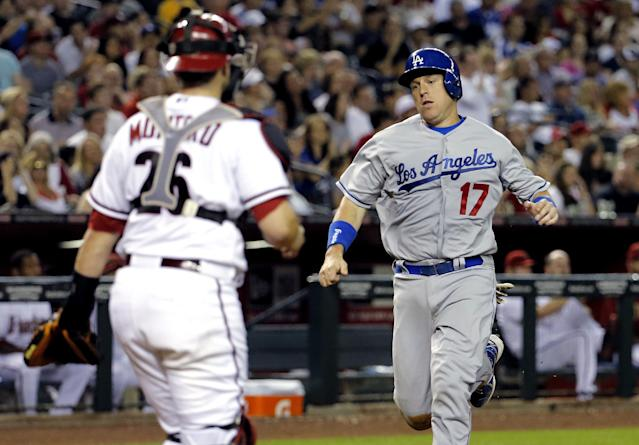 Los Angeles Dodgers' A.J Ellis scores on a double hit by teammate Zack Greinke as Arizona Diamondbacks' Miguel Montero waits for the throw during the fourth inning of a baseball game on Friday, May 16, 2014, in Phoenix. (AP Photo/Matt York)