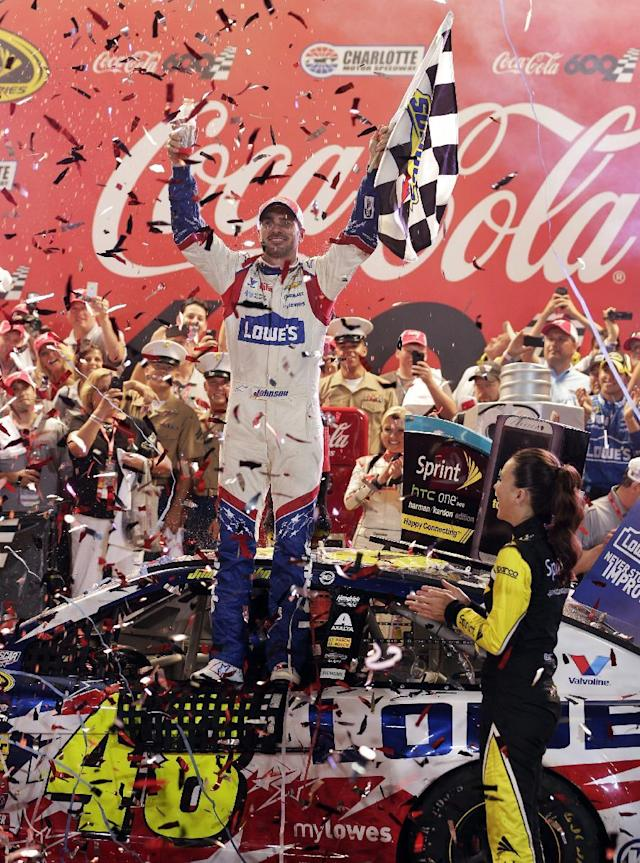 Driver Jimmie Johnson celebrates in Victory Lane after winning the NASCAR Sprint Cup series Coca-Cola 600 auto race at Charlotte Motor Speedway, Sunday, May 25, 2014, in Concord, N.C. (AP Photo/Chuck Burton)