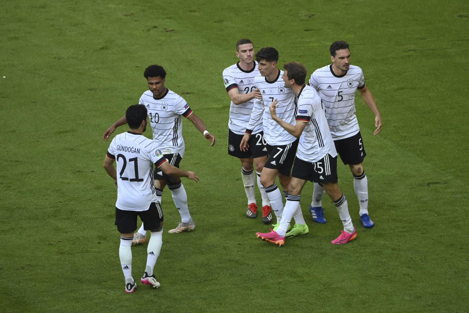 Germany's Kai Havertz, center, celebrates after scoring his side's opening goal during the Euro 2020 soccer championship group F match between Portugal and Germany at the football arena stadium in Munich, Saturday, June 19, 2021. (Matthias Hangst/Pool Photo via AP)
