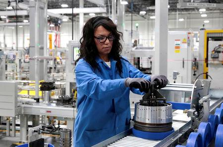 General Motors production worker Dina Mays works on the 10-speed transmission assembly at the General Motors (GM) Powertrain Transmission plant in Toledo, Ohio, U.S. March 6, 2019. REUTERS/Rebecca Cook/Files