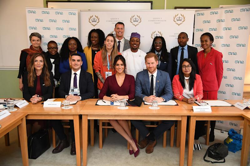 Britain's Prince Harry, Duke of Sussex (CR) and Meghan, Duchess of Sussex (CL) pose as they attend a roundtable discussion on gender equality with The Queens Commonwealth Trust (QCT) and One Young World at Windsor Castle in Windsor on October 25, 2019. (Photo by Jeremy Selwyn / POOL / AFP) (Photo by JEREMY SELWYN/POOL/AFP via Getty Images)