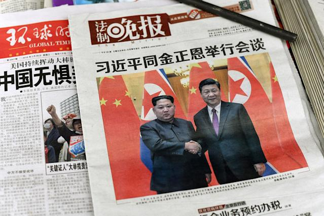 <p>The front pages of Chinese evening newspapers, showing images of China's President Xi Jinping with North Korean leader Kim Jong Un, are displayed at a newspaper stand in Beijing on March 28, 2018. (Photo: Fred Dufour/AFP/Getty Images) </p>